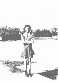 Angie Brown aka Angie Dickinson - 1940 - taken in front of the Edgeley Mail Newspaper Building where her parents, Bud & Rica Brown, and two other sisters lived in the upper level of the building.