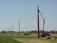 Building the Power Lines along Highway 13. August 14, 2003.