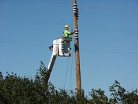 An Otter Tail Power Employee works at the Switch Station in NE Edgeley. Aug. 21, 2003.