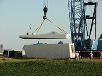 Removing the Lid to the nacelle before lifting it to the top of the tower. Aug. 21, 2003.