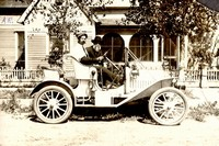 J.E. Bowen driving his REO Auto. His father is believed to be the passenger. The house in the background is the Turney-Farnsworth Home. Dakota Plains Credit Union sits on this site now.